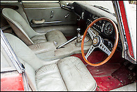 BNPS.co.uk (01202 558833)<br /> Pic: H&amp;HClassics/BNPS<br /> <br /> Needs a vacuum...<br /> <br /> It may look ready for the scrapheap, but this E-type Jaguar which has been left to rust for 40 years could fetch up to &pound;150,000 after restoration. <br /> <br /> The classic model, built in 1965, was purchased by its last owner in 1970 as a gift for his wife. <br /> <br /> And the Jaguar has remained in the garage, completely unused, ever since after the owner decided he couldn't bear to part with it.<br /> <br /> It is being sold following his death with a &pound;45,000 estimate by H&amp;H Classics at the  Imperial War Museum in Duxford, Cambs, on October 12.