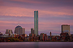 A sunset glows magenta on the Back Bay skyline over the Charles River, Boston, MA, USA