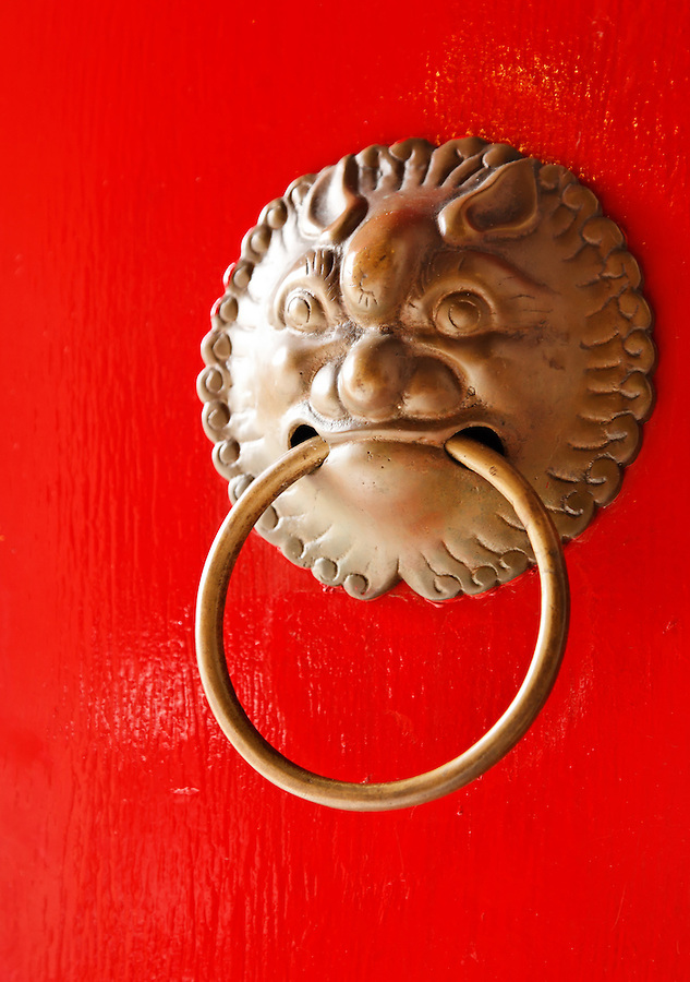 Door knocker on red door of temple in Po Fook Hill Cemetery, Sha Tin, New Territories, Hong Kong SAR, People's Republic of China, Asia