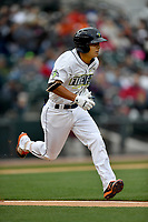 Shortstop Andres Jimenez (4) of the Columbia Fireflies runs toward first in a game against the Lakewood BlueClaws on Friday, May 5, 2017, at Spirit Communications Park in Columbia, South Carolina. Lakewood won, 12-2. (Tom Priddy/Four Seam Images)