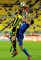 Wellington captain Andrew Durante and Adelaide keeper Paul Izzo compete for the ball during the A-League football match between Wellington Phoenix and Adelaide United at Westpac Stadium in Wellington, New Zealand on Saturday, 27 January 2018. Photo: Dave Lintott / lintottphoto.co.nz