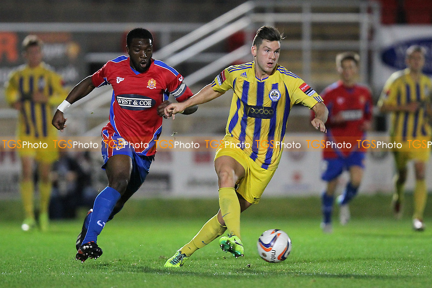 Tom Richardson of Romford and Oluwafemi Ilesanmi of Dagenham - Dagenham & Redbridge vs Romford - Essex FA Senior Cup 3rd Round Football at the London Borough of Barking & Dagenham Stadium - 29/10/13 - MANDATORY CREDIT: Gavin Ellis/TGSPHOTO - Self billing applies where appropriate - 0845 094 6026 - contact@tgsphoto.co.uk - NO UNPAID USE