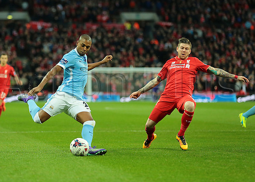 28.02.2016. Wembley Stadium, London, England. Capital One Cup Final. Manchester City versus Liverpool. Manchester City Midfielder Fernandinho shoots from a tight angle and scores past Liverpool Goalkeeper Simon Mignolet to make it 1-0 Manchester City