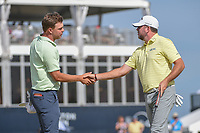 Keith Mitchell (USA) shakes hands with Robert Garrigus (USA) on 18 following round 4 of the Houston Open, Golf Club of Houston, Houston, Texas. 4/1/2018.<br /> Picture: Golffile | Ken Murray<br /> <br /> <br /> All photo usage must carry mandatory copyright credit (&copy; Golffile | Ken Murray)