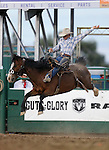 Andy Clarys rides in the saddle bronc competition at the Reno Rodeo in Reno, Nev. on Friday, June 19, 2015.<br /> Photo by Cathleen Allison/Nevada Photo Source