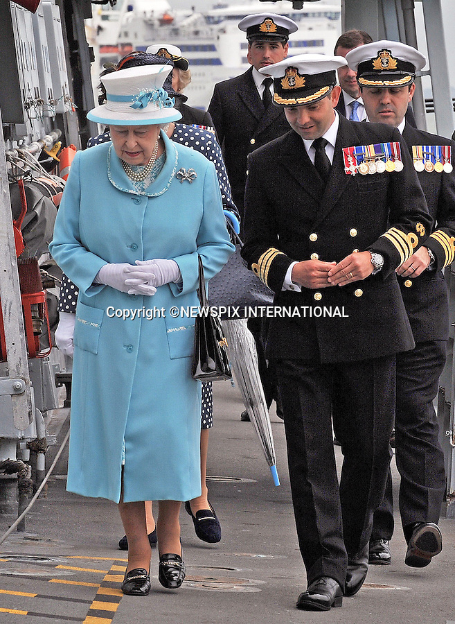 QUEEN ELIZABETH<br /> visits HMS Lancaster at Portsmouth Naval Base, Portsmouth_20/05/2014<br /> During her visit The Queen posed for a group photograph with the Ship's Company.<br /> Mandatory Credit Photo: &copy;MOD-Crown Copyright/NEWSPIX INTERNATIONAL<br /> <br /> **ALL FEES PAYABLE TO: &quot;NEWSPIX INTERNATIONAL&quot;**<br /> <br /> IMMEDIATE CONFIRMATION OF USAGE REQUIRED:<br /> Newspix International, 31 Chinnery Hill, Bishop's Stortford, ENGLAND CM23 3PS<br /> Tel:+441279 324672  ; Fax: +441279656877<br /> Mobile:  07775681153<br /> e-mail: info@newspixinternational.co.uk