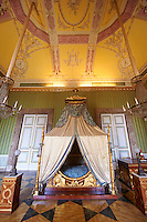 """The bedroom of Joachim Murat""  is decorated in the Empire style and comes from the Royal Palace of Portici, the favourite palace of  Joachim Murat and Caroline Bonaparte. The bed is mahogany designed by French Architedt Leconte.   The Bourbon Kings of Naples Royal Palace of Caserta, Italy."