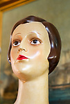 Female mannequin head close up 1920s haircut style, inside antiques centre, Marlesford Mill, Suffolk, England, UK