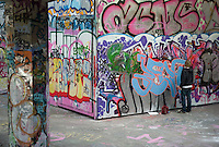 Walls covered with art and graffiti in the skateboarding area under Queen Elizabeth Hall on the South Bank, London, England