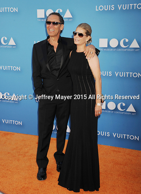 LOS ANGELES, CA - MAY 30: Musician Alex Van Halen and wife Stine Van Halen arrive at the 2015 MOCA Gala presented by Louis Vuitton at The Geffen Contemporary at MOCA on May 30, 2015 in Los Angeles, California.