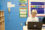 November 15, 2011. Mooresville, NC.. Sam Kern, a student at East Mooresville Intermediate School, works in class on his school issued laptop. . The Mooresville school system has become nationally known for being on the cutting edge of using technology as an educational tool. Starting in 3rd grade, each student is issued their own laptop that they will use in class and at home to further their learning.