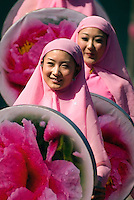 Dancers of the Hui ethnic group in Xinjiang, China perform in Miquan City..