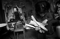 "Nagorny-Karabach, 12.05.2011, Shushi. Schauspielerinnen der Theaters von Schuschi proben unter einfachen Bedingungen. Eine Kollegin bring dabei Feuerholz, um den Ofen zu heizen. ""The Twentieth Spring"" - ein Portrait der s¸dkaukasischen Stadt Schuschi, 20 Jahre nach der Eroberung der Stadt durch armenische K?mpfer 1992 im B¸gerkrieg um die Unabh?ngigkeit Nagorny-Karabachs (1991-1994). Actresses of Shushi theater during a rehearsal under simple conditions. A colleague bring firewood to heat up the cold room. ""The Twentieth Spring"" - A portrait of Shushi, a south caucasian town 20 years after its ""Liberation"" by armenian fighters during the civil war for independence of Nagorny-Karabakh (1991-1994). .Actrices du théâtre de Chouchi  lors d'une répétition dans des conditions simples. Un collègue va chercher du bois pour chauffer la pièce glaciale.""Le Vingtieme Anniversaire"" - Un portrait de Chouchi, une ville du Caucase du Sud 20 ans après sa «libération» par les combattants arméniens pendant la guerre civile pour l'indépendance du Haut-Karabakh (1991-1994)..© Timo Vogt/Est&Ost, NO MODEL RELEASE !!"