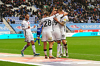 Sam Surridge of Swansea City celebrates scoring his side's second goal with team mates during the Sky Bet Championship match between Wigan Athletic and Swansea City at The DW Stadium in Wigan, England, UK. Saturday 2 November 2019