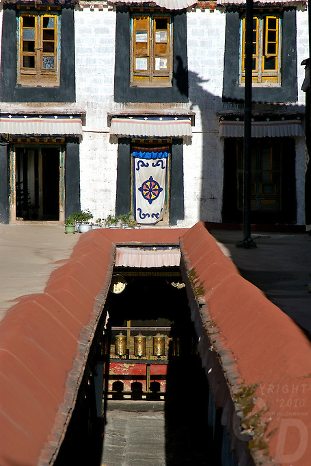 The colors of the Tibetan Monestries and Temples in Tibet.The Jokhang Temple is one of Tibet's holiest shrines, originally built in 647 A.D. in celebration of the marriage of the Tang Princess Wencheng and the Tubo King Songtsen Gampo. In front of the gate is a stone Tablet of Unity from the Tang Dynasty; inscribed are both Chinese characters and Tibetan script. Nearby is the stump of the willow tree said to have been planted by Princess Wencheng herself; two younger willow trees now flank the stump of the first tree...Located in the center of old Lhasa, the temple was built by craftsmen from Tibet, China, and Nepal and thus features different architectural styles. The temple is also the spiritual center of Tibet and the holiest destination for all Tibetan Buddhist pilgrims. In the central hall is the Jokhang's oldest and most precious object--a gold statue of a seated 12-year-old Sakyamuni. This is said to have been transported to Tibet by Princess Wencheng from her home in Changan in 700 A.D. Other precious antiques in the temple include a silk portrait of Buddha from the Tang Dynasty and a pearl gown and gold lamp from the Ming Dynasty. The three-leafed roof of the Jokhang offers splendid views of the bustling Barkhor market and across to the Potala Palace..
