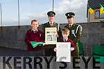 Sean Shanahan from 6th class and Darragh Manion from 5th class. presented with the Irish Tri Colour and Proclamation by Irish defence forces  Lt Denis Sheahan and Gunner Noel Lynch when they visited Scoil Mhuire de Lourdes Boys School Lixnaw  on Thursday