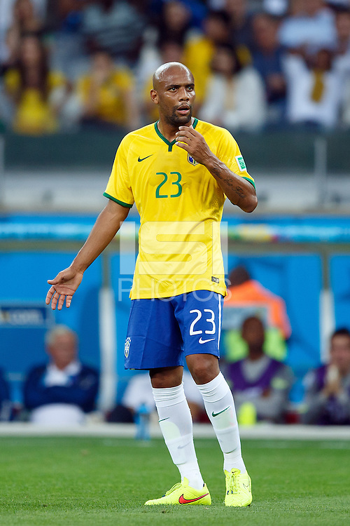 Maicon of Brazil looks dejected