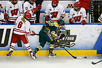 ST CHARLES, MO - MARCH 19:  Michaela Pejzlová (10) of the Clarkson Golden Knights gets past Presley Norby (6) of the Wisconsin Badgers with the puck during the Division I Women's Ice Hockey Championship held at The Family Arena on March 19, 2017 in St Charles, Missouri. Clarkson defeated Wisconsin 3-0 to win the national championship. (Photo by Mark Buckner/NCAA Photos via Getty Images)