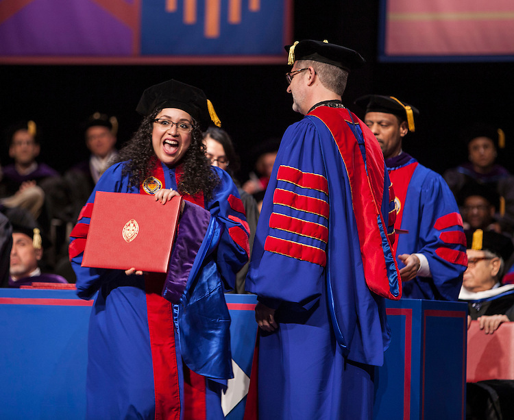 Students receive their degrees from the Rev. Dennis H. Holtschneider, C.M., president of DePaul, as the DePaul University College of Law held its commencement ceremony on May 17, 2015 at the Rosemont Theatre in Rosemont, IL, where some 280 students received their Juris Doctors or Master of Laws degrees. M. Cherif Bassiouni, DePaul emeritus professor of law, addressed the graduating class and received an honorary degree. (DePaul University/Jeff Carrion)