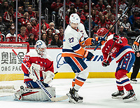 WASHINGTON, DC - JANUARY 31: Braden Holtby #70 of the Washington Capitals  saves on a deflection from Anders Lee #27 of the New York Islanders during a game between New York Islanders and Washington Capitals at Capital One Arena on January 31, 2020 in Washington, DC.