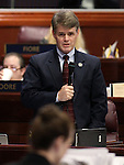 Nevada Assemblyman Chris Edwards, R-Las Vegas, speaks on the Assembly floor at the Legislative Building in Carson City, Nev., on Friday, May 22, 2015. <br /> Photo by Cathleen Allison