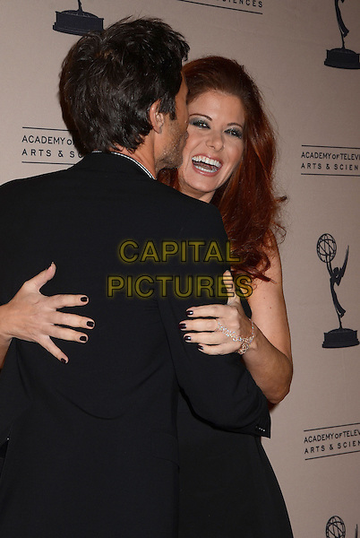 Eric McCormack, Debra Messing<br /> The Television Academy presents An Evening Honoring James Burrows at The Academy of Television Arts &amp; Sciences in North Hollywood, California, USA.<br /> October 7th, 2013<br /> half length dress suit back behind rear smiling laughing mouth open side black sleeveless hug embrace nail varnish polish<br /> CAP/ADM/BT<br /> &copy;Birdie Thompson/AdMedia/Capital Pictures