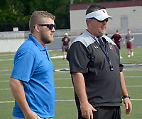 Graham Thomas/Herald-Leader<br /> Clinton Thurman, left, athletics director of the Boys & Girls Club of Western Benton County, visits with Siloam Springs head football coach Brandon Craig during a Panther Academy session on June 11 at Panther Stadium. The Boys & Girls Club is working in conjunction with the Siloam Springs football program to develop football players from the youth levels on up.