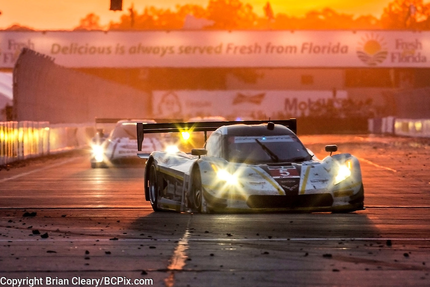 Sunset , #5 Corvette DP, João Barbosa, Sébastien Bourdais, Christian Fittipaldi  12 Hours of Sebring, Sebring International Raceway, Sebring, FL, March 2015.  (Photo by Brian Cleary/ www.bcpix.com )