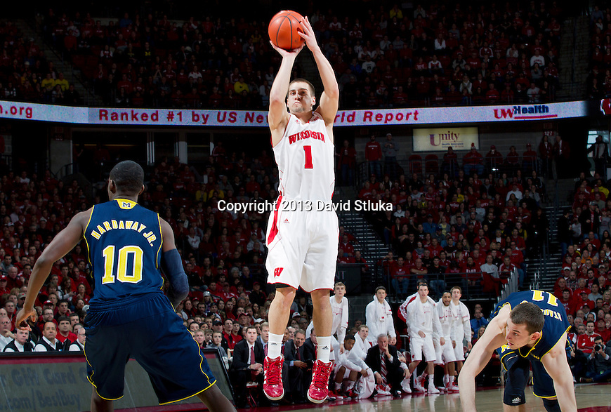 Wisconsin Badgers guard Ben Brust (1) shoots the ball during a Big Ten Conference NCAA college basketball game against the Michigan Wolverines Saturday, February 9, 2013, in Madison, Wis. The Badgers won 65-62 (OT). (Photo by David Stluka)