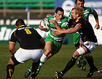 Manawatu first five Aaron Cruden tries to run between Matthew Luamanu and Mark Reddish during the Air NZ Cup preseason match between Manawatu Turbos and Wellington Lions at FMG Stadium, Palmerston North, New Zealand on Friday, 17 July 2009. Photo: Dave Lintott / lintottphoto.co.nz