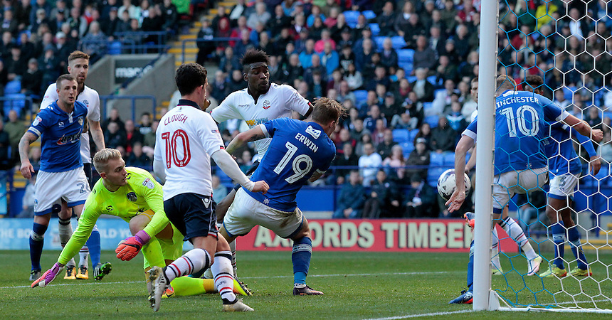 Bolton Wanderers' Sammy Ameobi sees his shot cleared off the line by Oldham Athletic's Carl Winchester<br /> <br /> Photographer David Shipman/CameraSport<br /> <br /> The EFL Sky Bet League One - Bolton Wanderers v Oldham Athletic - Saturday 15th October 2016 - Macron Stadium - Bolton<br /> <br /> World Copyright &copy; 2016 CameraSport. All rights reserved. 43 Linden Ave. Countesthorpe. Leicester. England. LE8 5PG - Tel: +44 (0) 116 277 4147 - admin@camerasport.com - www.camerasport.com
