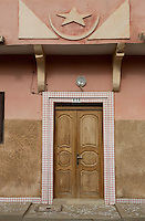 Senegal, Saint Louis.  Doorway to Private Residence with Islamic Star and Crescent Above.