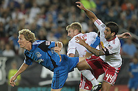 San Jose Earthquakes forward Steven Lenhart (24) heads the ball into the goal against New York Red Bulls defender Tim Ream (5) and New York Red Bulls defender Carlos Mendes (44). The San Jose Earthquakes tied the New York Red Bulls 2-2 at Stanford Stadium in Stanford, California on July 2nd, 2011.