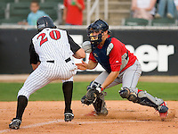 Catcher Travis D'Arnaud #5 of the Lakewood BlueClaws waits for the throw as Jon Gilmore #20 of the Kannapolis Intimidators steams towards home plate at Fieldcrest Cannon Stadium May 16, 2009 in Kannapolis, North Carolina. (Photo by Brian Westerholt / Four Seam Images)