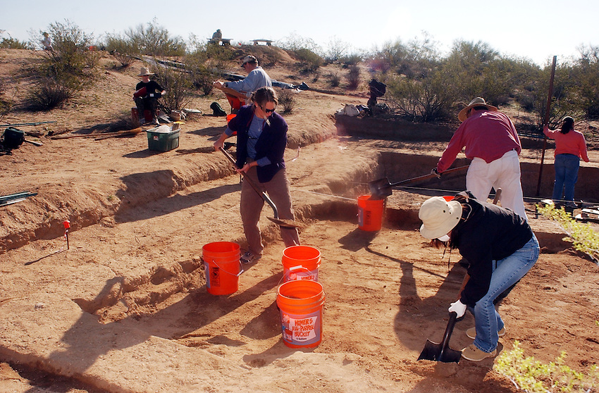 Marty Robinson (white pants).Tanya Wang (left).and Wannasarn Noonsuk from Hawaii.digf dirt from.the Marana Platform mound looking for.shards and other artifacts from the .mound occupied for 100 years by the HoHoKam.people from 1200 ad to 1300 ad...