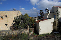 Pictured: Rear view of the boundary wall between the Hattons' house (L) with their neighbours' house (R) Wednesday 15 February 2017<br /> Re: John and Heather Hatton, expat couple in Greece who are unable to sell their house in the village of Vamos, Chania, Crete to return to the UK because their neighbour won't pay his taxes.<br /> Heather Hatton needs to return to the UK for urgent medical care.