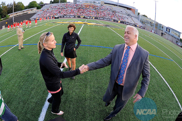 25 MAY 2014:   Head coach Gary Gait of the Syracuse Orange shakes hands with head coach Cathy Reese of the Maryland Terrapins before the Division I Women's Lacrosse Championship held at Unitas Stadium in Towson, MD.  Maryland defeated Syracuse 15-12 for the national title.  Greg Fiume/NCAA Photos