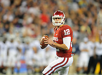 Jan. 1, 2011; Glendale, AZ, USA; Oklahoma Sooners quarterback (12) Landry Jones drops back to pass against the Connecticut Huskies in the 2011 Fiesta Bowl at University of Phoenix Stadium. Mandatory Credit: Mark J. Rebilas-.