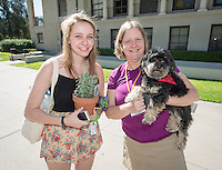 Tressa Naylor '17 and her mother Julie Naylor enjoy the quad with Riley. Students and parents enjoy Good Food Day, part of Food Justice Month, sponsored by FEAST in the JSC quad on Oct. 24, 2014. The event featured free ice cream, free local apples and caramel, potted herbs and succulents, A taro pounding demonstration from the Hawaii Club, free local and organic food from the Green Truck and a Real Food Challenge commitment. (Photo by Marc Campos, Occidental College Photographer)