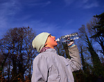 ARM4B3 Girl in grey drinking water from a bottle