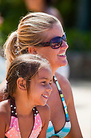 Mother and daughter smiling on the beach in Waikiki