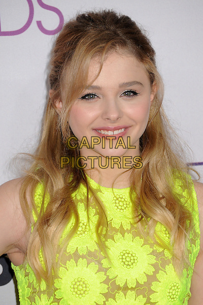 Chloe Grace Moretz.People's Choice Awards 2013 - Arrivals held at Nokia Theatre L.A. Live, Los Angeles, California, USA..January 9th, 2013.headshot portrait green yellow floral print sleeveless  .CAP/ADM/BP.©Byron Purvis/AdMedia/Capital Pictures.