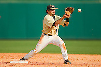 Wake Forest Demon Deacons shortstop Pat Blair #11 takes a throw at second base against the North Carolina State Wolfpack at Doak Field at Dail Park on March 17, 2012 in Raleigh, North Carolina.  The Wolfpack defeated the Demon Deacons 6-2.  (Brian Westerholt/Four Seam Images)