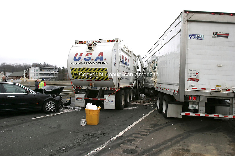 WATERBURY, CT 4/2/07- 040207BZ07- An accident involving a tractor trailer, Jaguar, garbarge truck, and another vehicle on Route 8 northbound closed the highway and caused traffic delays Monday.<br /> Jamison C. Bazinet Republican-American