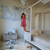 Celia's bedroom is decorated with Andre Charles's Diva graffiti and furnished with a bed and chest by Bonnie Young