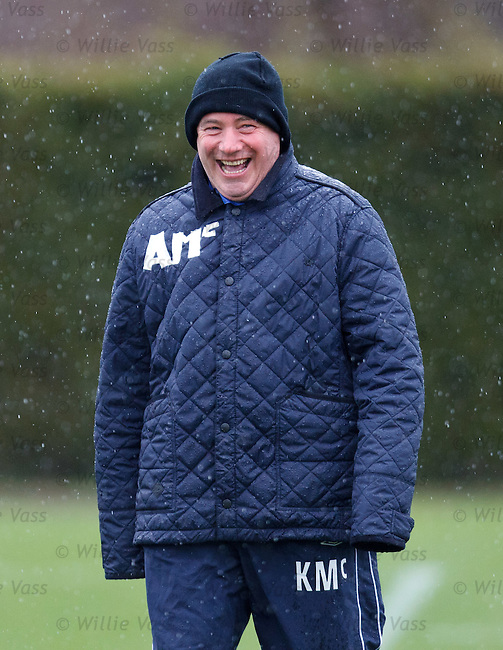 Ally McCoist laughing after he uses strips of white tape to mark his initials on his jacket