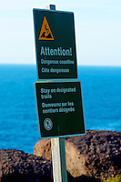 Dangerous coastline sign French and English