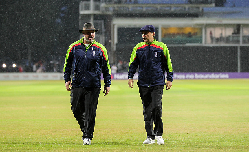 Umpires Blackwell and O'Shaughnessy leave the field due to heavy rainfall.<br /> <br /> Photographer Andrew Kearns/CameraSport<br /> <br /> NatWest T20 Blast - Leicestershire Foxes vs Northamptonshire Steelbacks - Friday 21st July 2017 - Grace Road Leicester <br /> <br /> World Copyright &copy; 2017 CameraSport. All rights reserved. 43 Linden Ave. Countesthorpe. Leicester. England. LE8 5PG - Tel: +44 (0) 116 277 4147 - admin@camerasport.com - www.camerasport.com