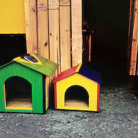 Dog houses, painted in national flag colors of Brazil and Colombia, are seen for sale on the street in Cali, Colombia, 26 June 2014.