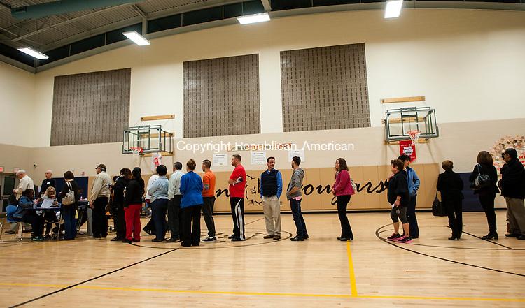 WATERBURY, CT-4 November 2014-110414EC06-  Voters wait in line at Carrington Elementary School in Waterbury Tuesday night. Erin Covey Republican-American